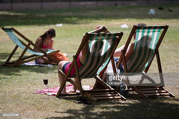 Members of the public enjoy the warm weather in St James's Park on July 16 2014 in London England The Met Office has issued a heatwave alert as...