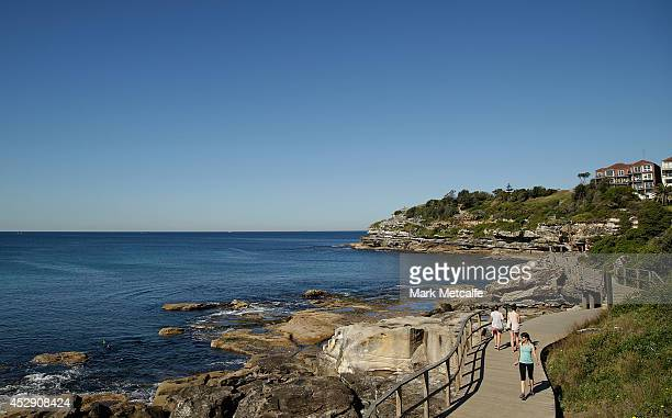 Members of the public enjoy the warm weather on the coastal walk path south of Bondi Beach on July 30 2014 in Sydney Australia Sydney forecast to hit...