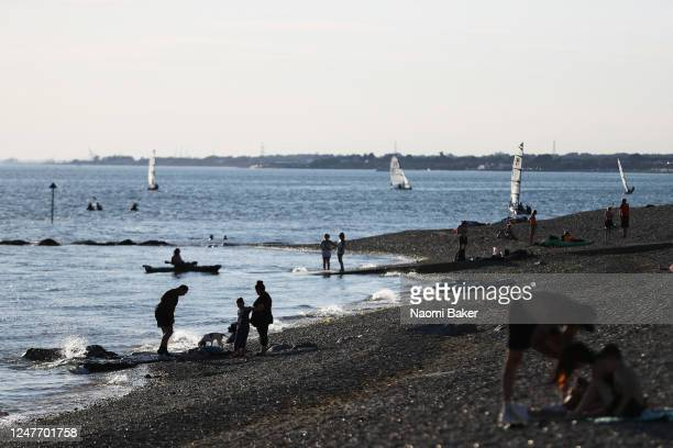 Members of the public enjoy the weather at the beach on June 06 2020 in LeeOnTheSolent England The British government further relaxed Covid19...
