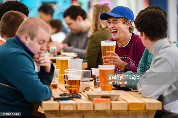 Members of the public enjoy their first drink in a beer garden at SWG3 on July 06, 2020 in Glasgow, Scotland. Beer gardens across Scotland are...