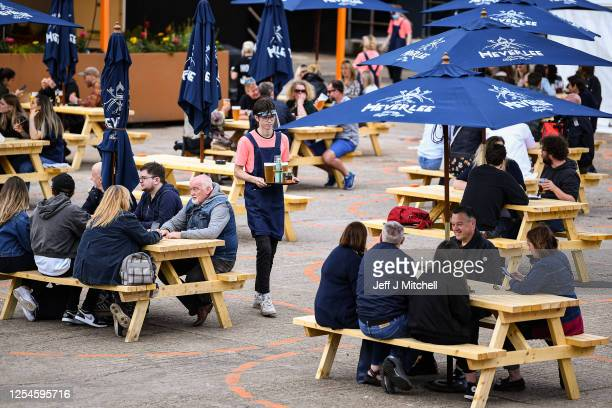 Members of the public enjoy their first drink in a beer garden at SWG3 multi – disciplinary arts venue on July 06 2020 in Glasgow Scotland Beer...