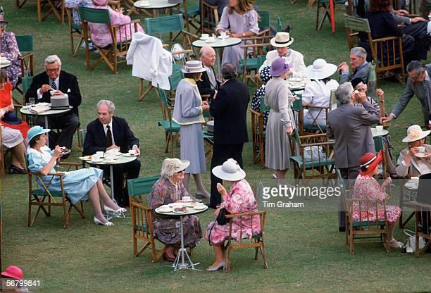 Members of the public enjoying tea at a Buckingham Palace garden party