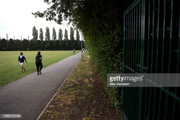 Members of the Public exercise in Wimbledon Park which would normally be full of people camping and queuing on June 29 2020 in Wimbledon England The...