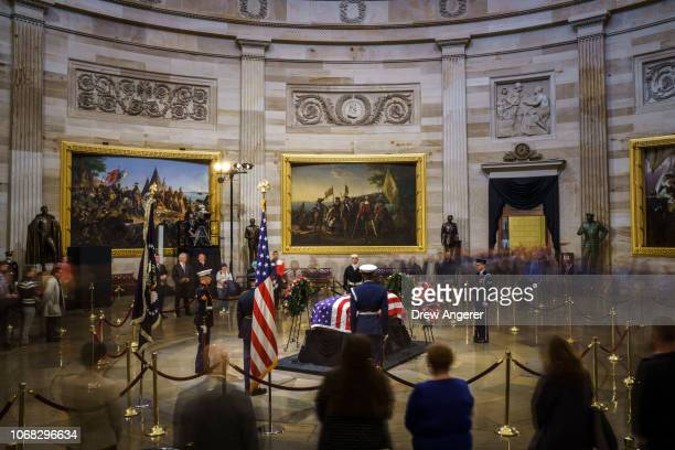 Members of the public file through the Capitol Rotunda to view the casket of the late former President George HW Bush as he lies in state December 4...