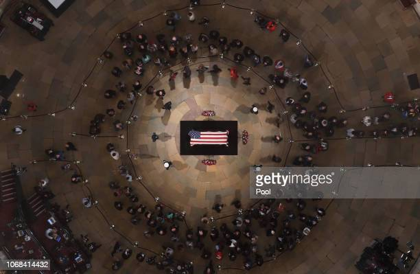 Members of the public file through the Capitol Rotunda to view the flagdraped casket of the late former President George HW Bush as he lies in state...