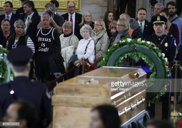 Members of the public file through the Rotunda of the US Capitol to view the casket containing the remains of evangelist Rev Billy Graham on February...
