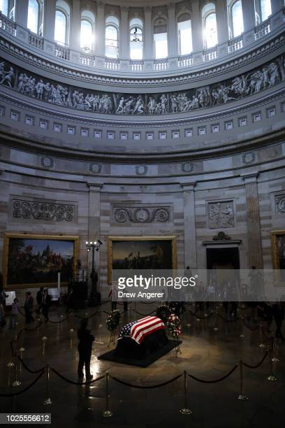 Members of the public file through the Rotunda to pay their respects to the late-Sen. John McCain as his casket lies in state during a memorial...
