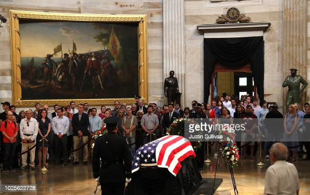Members of the public file through the Rotunda to pay their respects to the lateSen John McCain as his casket lies in state during a memorial service...