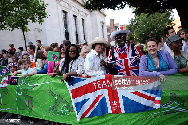 Members of the public gather as Comedian David Walliams sets off with the Olympic Torch from Islington Town Hall on day 69 of the London 2012 Olympic...