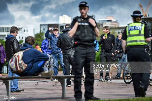 Members of the public gather at Glasgow Green, as part gatherings taking place this weekend across Scotland and the UK-wide against the coronavirus...
