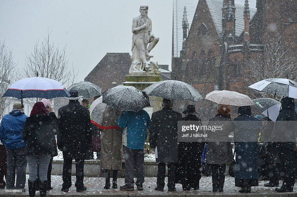 Members of the public gather at the Robert Burns statue, as part of events taking place to celebrate the birth of poet Robert Burn on January 25, 2012 in Dumfries, Scotland. Burns suppers will be held today to commemorate the life of the poet Robert Burns, who was born on this day in 1759.