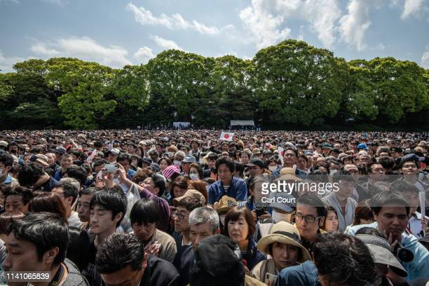 Members of the public gather in the grounds of the Imperial Palace ahead of a public address by Emperor Naruhito of Japan on May 4 2019 in Tokyo...