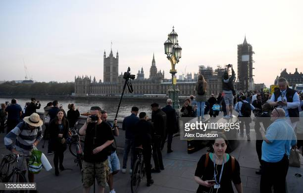 """Members of the public gather on Westminster Bridge on April 23, 2020 in London, United Kingdom. Following the success of the """"Clap for Our Carers""""..."""