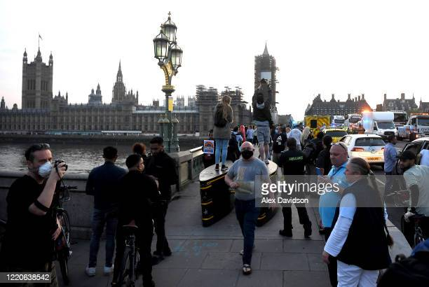 Members of the public gather on Westminster Bridge on April 23 2020 in London United Kingdom Following the success of the Clap for Our Carers...