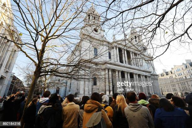 Members of the public gather outside St Paul's Cathedral ahead of the Grenfell Tower national memorial service on December 14 2017 in London England...