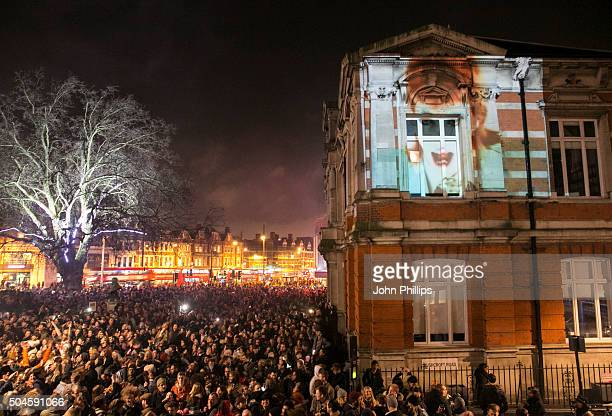 Members of the public gather outside the Ritzy Cinema in Brixton to pay tribute to David Bowie on January 11 2016 in London England British music and...