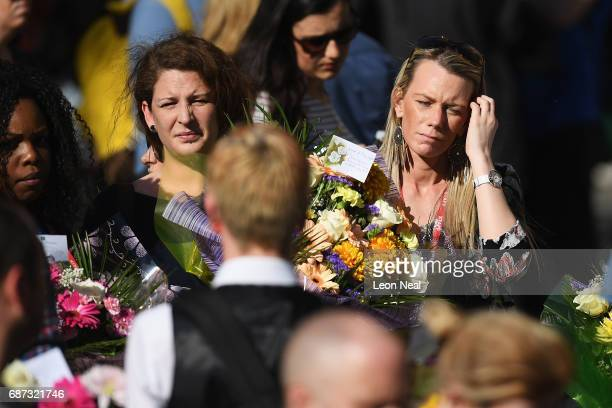 Members of the public gather to attend a candlelit vigil to honour the victims of Monday evening's terror attack at Albert Square on May 23 2017 in...
