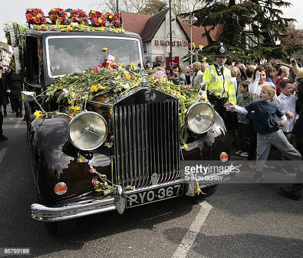 Members of the public gather to watch reality television star Jade Goody's funeral procession as it passes along Loughton high road in Essex on April...