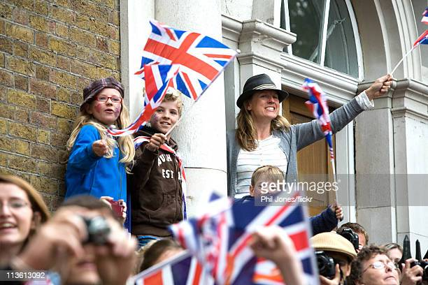 Members of the public gather to watch the Royal Wedding of Prince William to Catherine Middleton at Westminster Abbey on April 29 2011 in London...