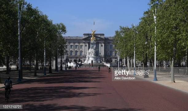 Members of the public go down The Mall where the finish of the London Marathon was due to take place on April 26 2020 in London England The 40th...