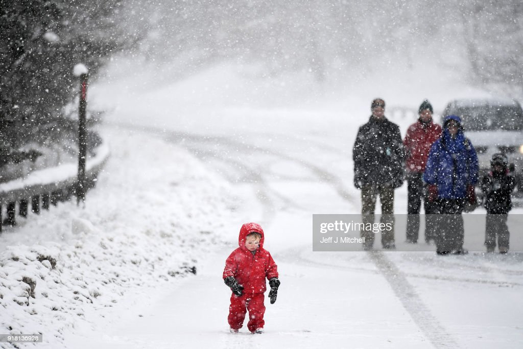 Members of the public go out in the snowy conditions next to the A93 road on February 14, 2018 in Spittal of Glenshee, Scotland. Weather forecaster issued another yellow be aware warning as snow and high winds are set to affect the higher parts of Scotland.
