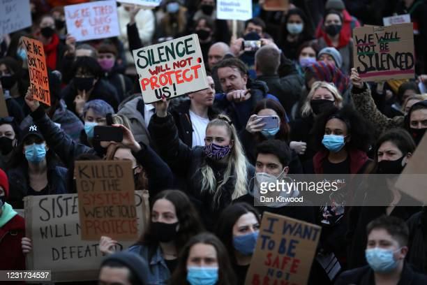 Members of the public hold up signs during a protest in Parliament Square against the The Police, Crime, Sentencing and Courts Bill and criticising...