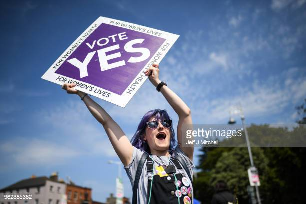 Members of the public hold yes placards on Fairview road as the country heads to polling stations on May 25 2018 in Dublin Ireland Polling stations...