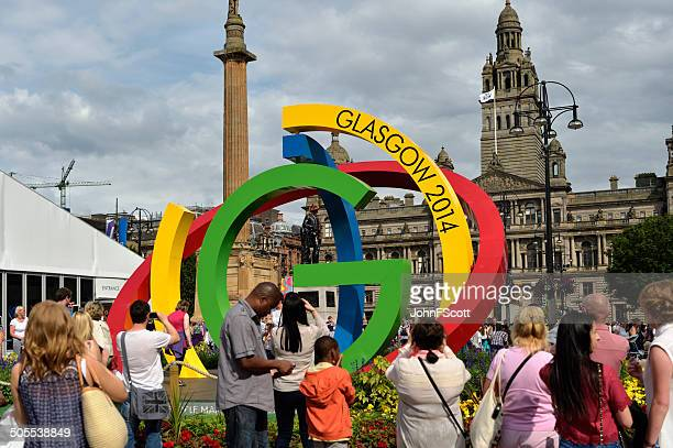 members of the public in george square glasgow 2014 - glasgow scotland stock photos and pictures