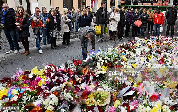 Members of the public lay floral tributes near to the scene of yesterdays bin lorry crash on December 23 2014 in GlasgowScotland Six people were...