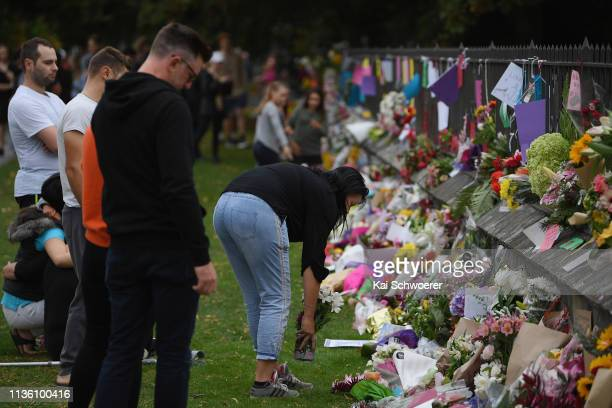 Members of the public lay flowers and condolences at the entrance to the Christchurch Botanic Gardens close to Al Noor mosque on March 16 2019 in...