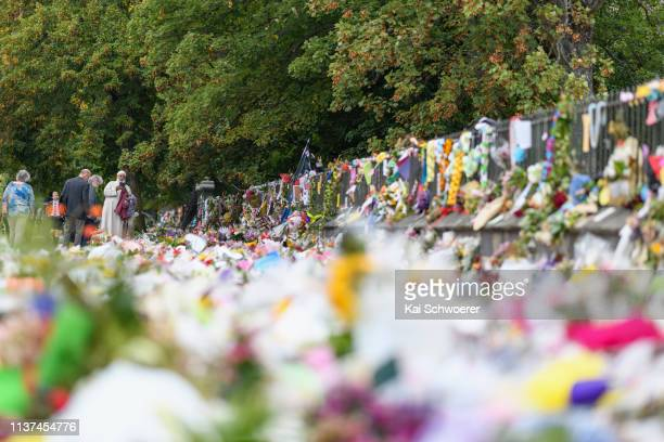 Members of the public lay flowers and condolences at the entrance to the Christchurch Botanic Gardens close to Al Noor mosque on March 22 2019 in...