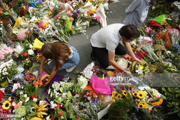 Members of the public lay flowers at the Kilbirnie Mosque on March 17 2019 in Wellington New Zealand 50 people are confirmed dead and 36 are injured...