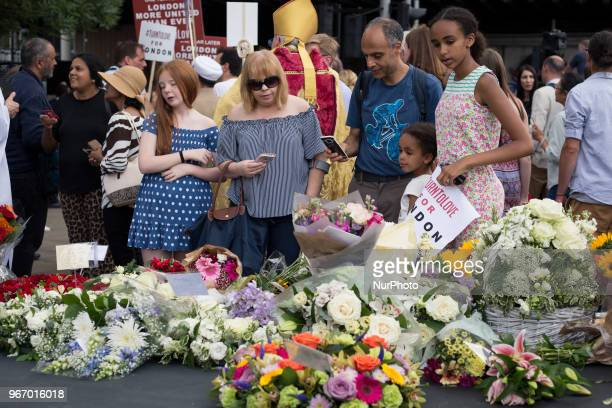 Members of the public lay flowers at the London Bridge after a commemoration service on the first anniversary of the London Bridge terror attack in...