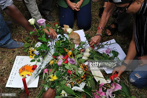 Members of the public lay flowers during a vigil at the Nairobi National Park on April 3 2016 as they pay their respect to the majestic lion called...