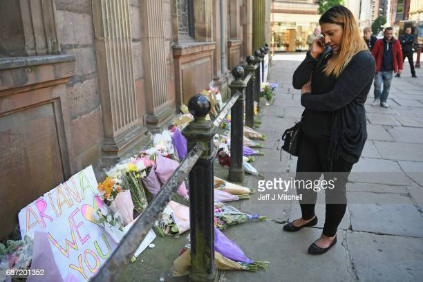 Members of the public lay flowers in St Ann Square on Tuesday May 23 2017 in ManchesterEngland At least 22 people were killed in a suicide bombing at...