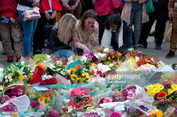 Members of the public lay flowers near the scene of the London Bridge terrorist attacks on June 7 2017 in London England The third attacker has been...