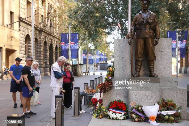 Members of the public lay flowers on The Cenotaph, Martin Place on April 25, 2020 in Sydney, Australia. Traditional Anzac Day ceremonies have been...
