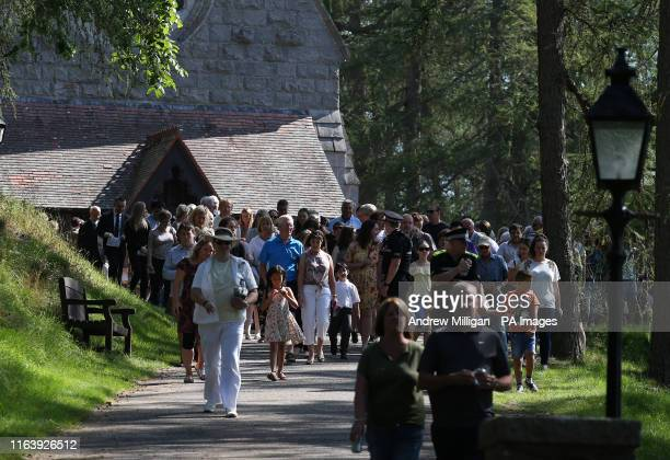 Members of the public leave Crathie Kirk after watching the royal family departing following the Sunday church service near Balmoral, where members...