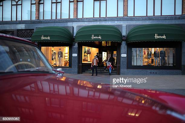 Members of the public leave Harrods department store on January 4 2017 in London England The union that represents the catering staff at Harrods'...