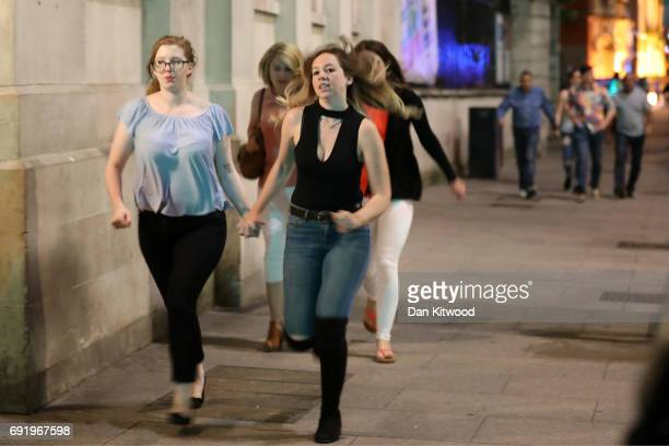 Members of the public leave the area at London Bridge on June 3 2017 in London England Police have responded to reports of a van hitting pedestrians...