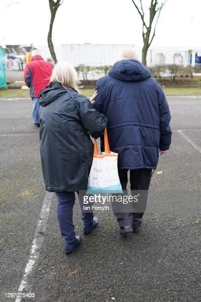 Members of the public leave the Askham Bar Mass Vaccination Centre in York after receiving the AstraZeneca/Oxford University covid-19 vaccination on...