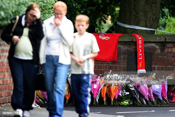 Members of the public leave the scene of the murder of Anthony Walker after laying a floral tribute The black teenager was killed at the entrance to...