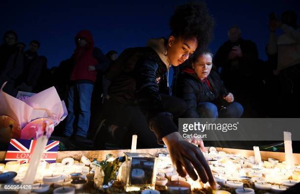Members of the public light candles during a candlelit vigil at Trafalgar Square on March 23 2017 in London England Four People were killed in...