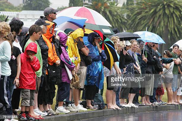 Members of the public line the road at the Auckland Domain as they await the hearse carrying Sir Edmund Hillary following the State Funeral on...