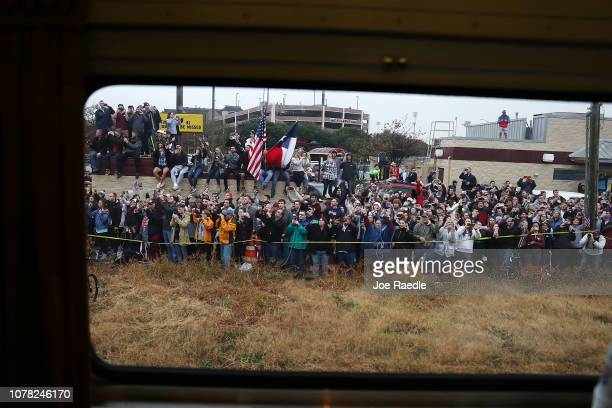 Members of the public line the route to pay their respects as the train carrying former President George HW Bush to his final resting place passes by...
