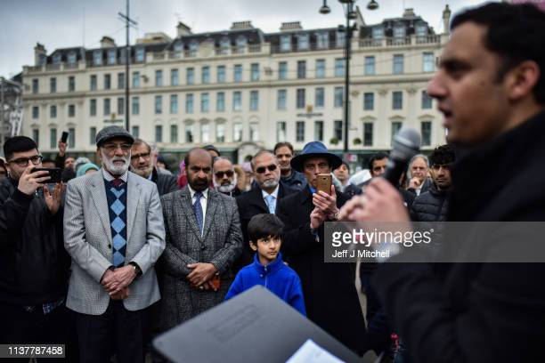 Members of the public listen to Anas Sarwar a Scottish Labour Party politician as they attend a vigil in George Square to pay their respects for the...