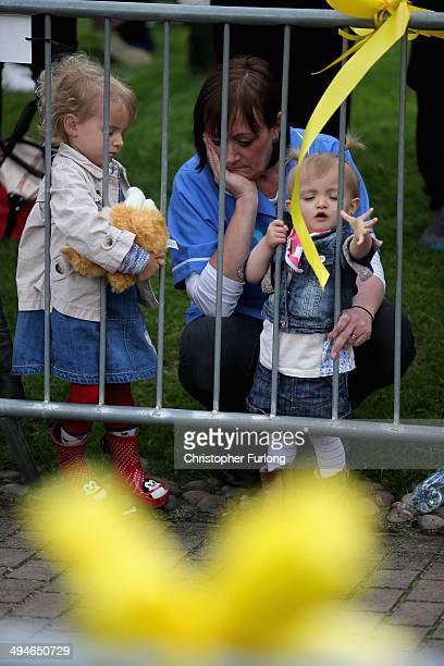 Members of the public listen to the funeral service of teenage cancer fundraiser Stephen Sutton outside Lichfield Cathedral on May 30 2014 in...