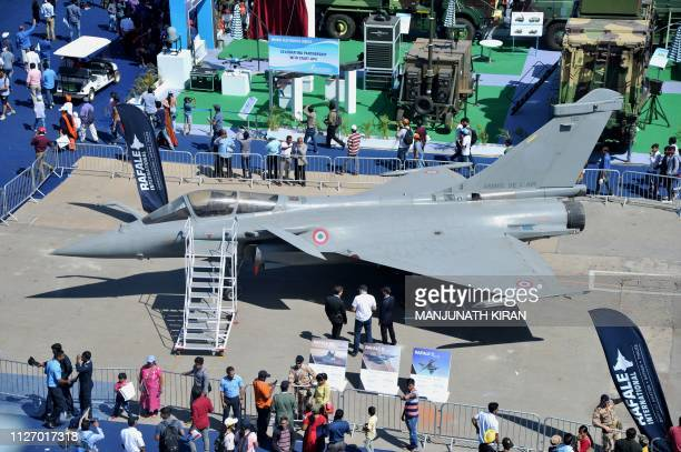 Members of the public look at a Dassault Rafale fighter aircraft during the final day of Aero India 2019 airshow at the Yelahanka Air Force Station...
