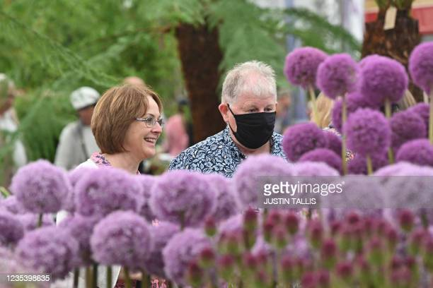 Members of the public look at displays on show at the 2021 RHS Chelsea Flower Show in London on September 21, 2021.
