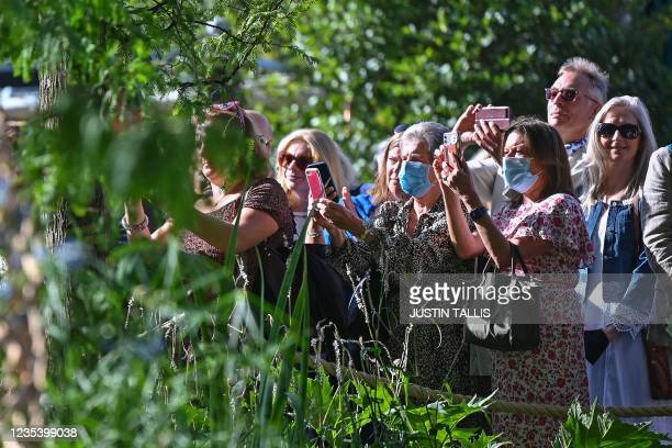 Members of the public look at the Guangzhou Garden as it won 'Best in show' award at the 2021 RHS Chelsea Flower Show in London on September 21, 2021.